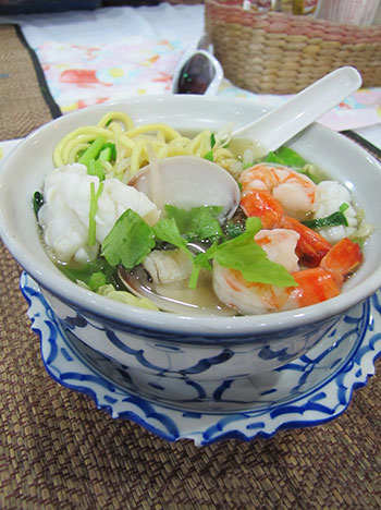 Yellow noodle soup with seafood